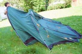 Растянуть внешний тент Четырехместная кемпинговая палатка-полубочка с большим тамбуром. Alexika Apollo 4
